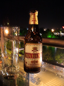 A bottle of Bia Hanoi at night