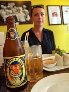 A bottle of Bierre Larue on the dinner table